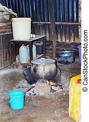 Typical African kitchen, cooking food over wood and charcoal fire