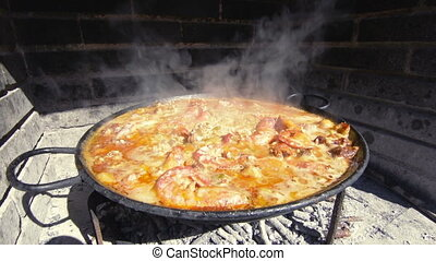 Typical and traditional spanish paella - Spanish paella, a...