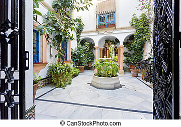 Typical Andalusian patio with fountain and plants