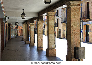 typical arcaded streets of the city of Burgo de Osma in Spain