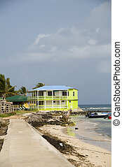 typical architecture colorful concrete building breakwater promenade on Caribbean Sea with fishing boats Big Corn Island Nicaragua Central America