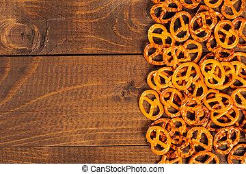 Typical bavarian pretzel on old wooden table