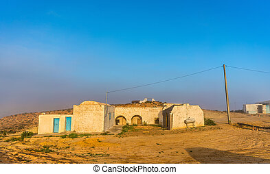 Typical berber house in the Tunisian countryside at Tataouine