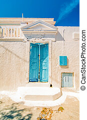 Typical blue door in Emporio on the island of Santorini, Greece, Southern Europe