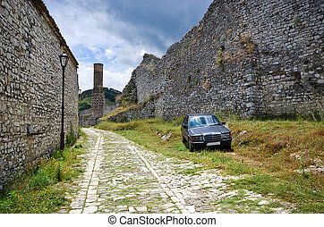 Typical car on old courtyard in Albania, Berat