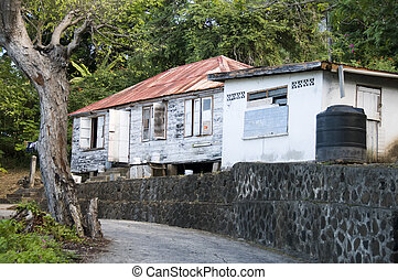 caribbean island house with zinc roof and plastic water tank cistern bequia st. vincent and the grenadines