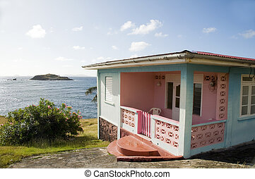typical colorful caribbean style house in bequia st. vincent and the grenadines islands waterfront caribbean sea