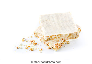 Typical christmas almond nougat isolated on white background
