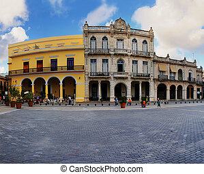 Typical colonial buildings in Old havana plaza - A view of...
