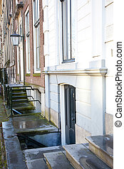 Typical Dutch entrance below the street of a old house