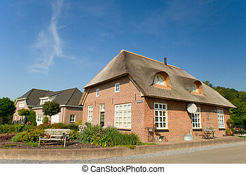 Typical Dutch farm house with reed roof