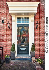 Typical Dutch front door - Classic wooden door in Amsterdam,...