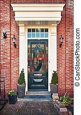 Typical Dutch front door - Classic wooden door in Amsterdam,...