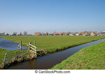 Typical Dutch landscape with meadows and ditches