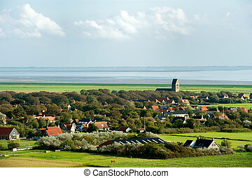 Typical Dutch village Hollum at the wadden island in Holland