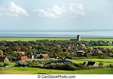 Typical Dutch village Hollum at the wadden island in Holland