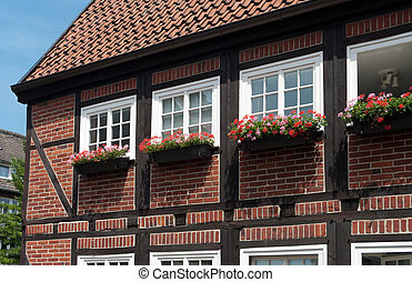 typical half-timbered German house with flower planters outside the windows