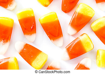 Typical halloween candy corn isolated on white background. Top view. Close up