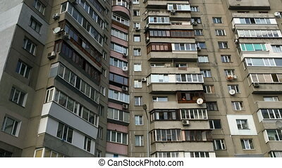 Typical high rise apartment building with balcony and windows. Contemporary architecture. Selective focus. Close-up. Outdoors.