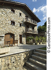 Typical house in the Pyrenees with cloud sky