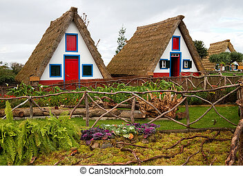 Old traditional houses in the village of Santana, Madeira.