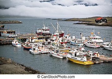 Typical Iceland Harbor with Fishing Boats at Overcast Day