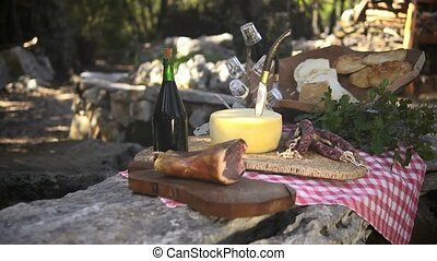 Typical Italian food on display - Cheese, ham, salami and...
