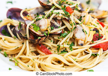 spagetti with vongole clams on plate close up