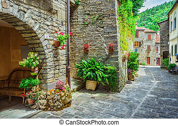 Italian street in a small provincial town of Tuscan -...