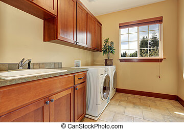 Typical laundry room with tile floor.