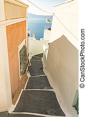 typical little street in santorini in greece in cyclades