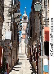 Typical narrow street in old medieval town Korcula by suny day
