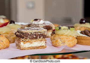 Typical Neapolitan pastry, with yellow cream and strawberry, Naples, Italy