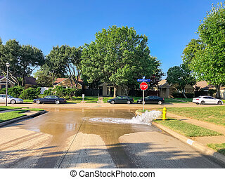 Typical neighborhood area with stop sign near Dallas, Texas, America with open yellow fire hydrant
