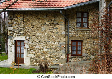 typical frontage of an old french farm in the alps