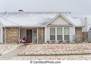 Typical residential house in snow cover near Dallas, Texas, USA