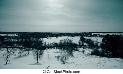Typical Russian winter scenery involving distant town, pan...
