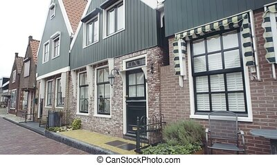 Typical small Dutch houses facades in Volendam, Netherlands