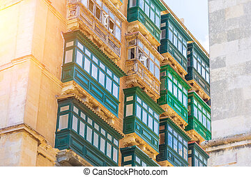 Typical traditional green balconies in the center of Valletta in Malta.