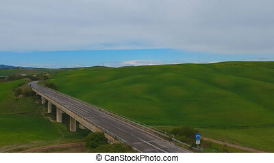 Typical Tuscany green grass hills. Aerial drone video shot....