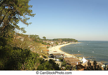 Typical view of Arcachon beach bay with houses and boats