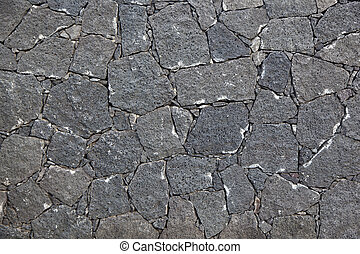 typical wall made seamless from volcanic stone