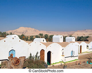 Typical white small egyptian house, Oasis of Dakhla, Lybian desert, Egypt