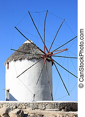 Typical windmill on a hillside near the sea in Mykonos Island, Greece