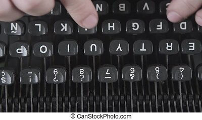 Typing a film script or a book on a vintage typerwriter -...