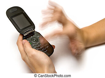 Typing a SMS on a cell phone.