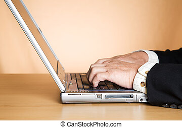 Typing businessman