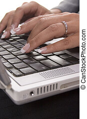 Typing - Female typing on a laptop
