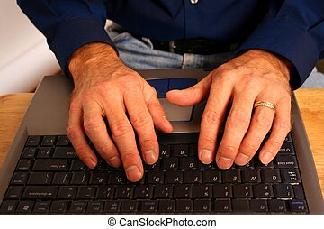 Typing Hands - hands of caucasian man working offsite on his...