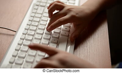 typing on a keyboard. Child hands